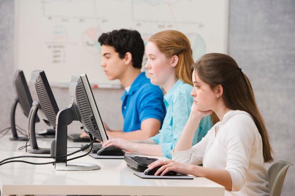 three teenagers in classroom 600x400 1 Study in Switzerland